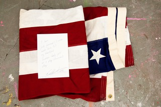 Romantic Testimony (American Flag Obsession in New York), 2013, performance/painting collaboration with Will Hudson, vintage American flag, paper (scale depending on how it is shown), address is subject to confidentiality agreement with Will Hudson, Manhattan, New York